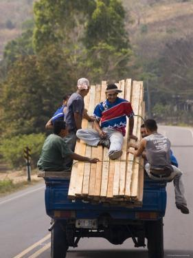 Men Riding on Back of Truck Carrying Timber, Near Esteli, Nicaragua by Margie Politzer