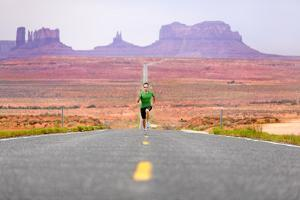 Running Man - Runner Sprinting on Road by Monument Valley. Concept with Sprinting Fast Training For by Maridav