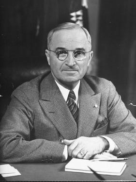 Harry S. Truman Sitting at Desk by Marie Hansen