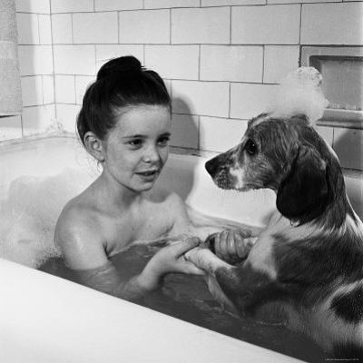 Margaret O'Brien and Her Spaniel Maggie Share a Bubble Bath by Marie Hansen
