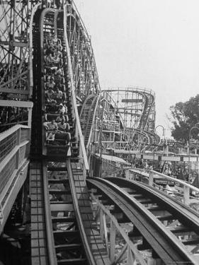 Thrill Seekers Getting a Hair Raising Ride on Cyclone Roller Coaster at Coney Island Amusement Park by Marie Hansen