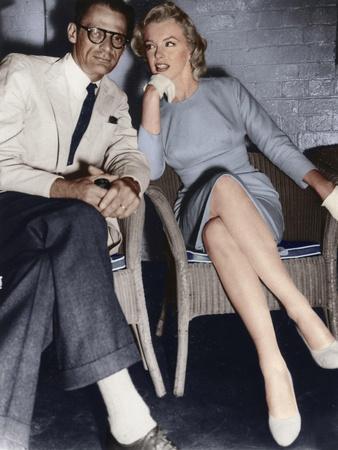 https://imgc.allpostersimages.com/img/posters/marilyn-monroe-and-arthur-miller-just-arrived-in-london-c1956-1957_u-L-Q1IENN60.jpg?artPerspective=n