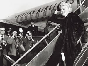 Marilyn Monroe Boards Airplane, New York, c.1956