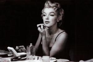 Marilyn Monroe (in the mirror)
