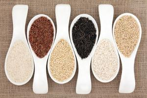 Rice Grain Selection In White Porcelain Scoops Over Hessian Background by marilyna