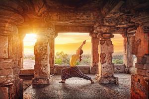 Yoga in Hampi Temple by Marina Pissarova