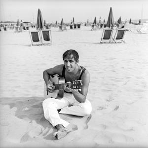 Adriano Celentano with the Guitar at the Beach by Marisa Rastellini