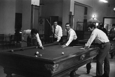 Four Friends Playing Billiards