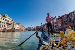 Gondolier paddling a gondola in Venice, Italy, Europe by Mark A Johnson