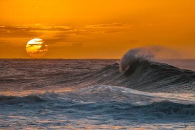 Pau Hana-Sunset & Wave breaking off of the Na Pali Coast of Kauai, Hawaii by Mark A Johnson