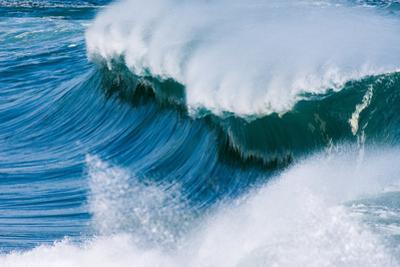 Powerful wave breaking off a beach, Hawaii by Mark A Johnson
