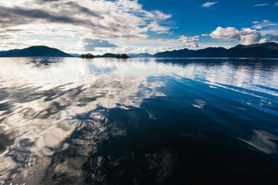 Reflections in the calm waters of the Inside Passage, Southeast Alaska, USA by Mark A Johnson