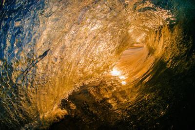 Spun Gold-Inside a tubing wave at sunset, shot from the water, Kirra, Queensland, Australia by Mark A Johnson