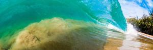 Water shot of a tubing shore break wave crashing onto a Hawaiian beach by Mark A Johnson