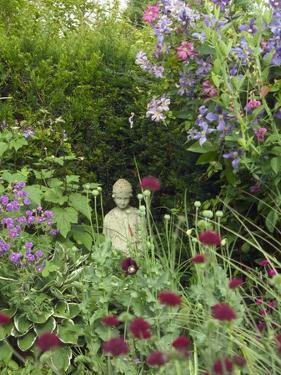 Small Statue in a Back Garden by Mark Bolton