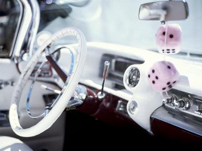 Close-Up of Steering Wheel and Interior of a Pink Cadillac Car