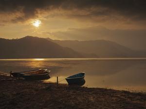 Local Fishing Boats on Phewa Lake at Sunset, Gandak, Nepal, Asia by Mark Chivers