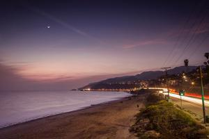 Sunset on Will Rogers Beach and the Pacific Coast Highway by Mark Chivers