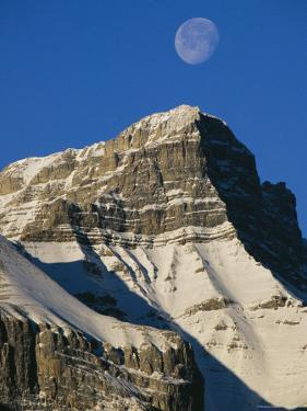 Daytime View of the Moon Above Mount Rundle in Canadas Rocky Mountains by Mark Cosslett