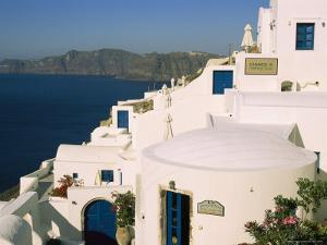 Houses with Blue Doors and Window Frames Overlook the Aegean Sea by Mark Cosslett