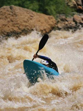 Kayaker Paddles Through Colorado River Rapids by Mark Cosslett