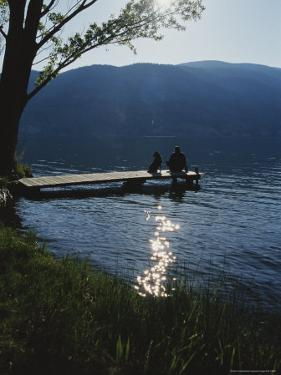 Man and His Dog on a Lake Skaha Dock by Mark Cosslett
