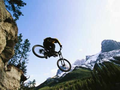 Man Jumping on His Mountain Bike with Ha Ling Peak in the Background by Mark Cosslett