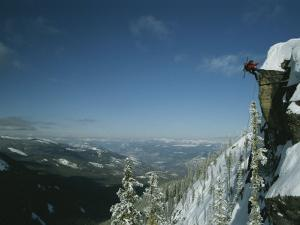 Rappeling with Snowboard, Red Mountain, British Columbia by Mark Cosslett