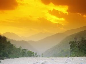 Sunset with Mountains and Trees over the Karnali River in Nepal by Mark Cosslett
