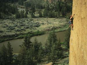 Woman Climbs the Latest Rage Above the Crooked River by Mark Cosslett