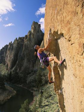 Young Man Climbs Scarface Above the Crooked River Below by Mark Cosslett