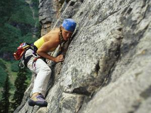 Young Woman Climbs Cliff at Lake Louise by Mark Cosslett
