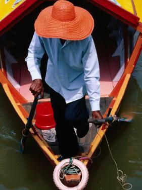Helmsman Manoeuvres Sampan or Ferry on Sarawak River, Kuching, Sarawak, Malaysia by Mark Daffey