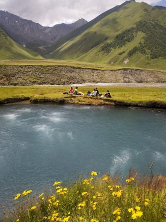 Hiking Group Resting Beside Mineral Spring in Truso Valley