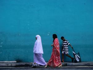 Indian Family on Clive Street in Little India, Singapore by Mark Daffey