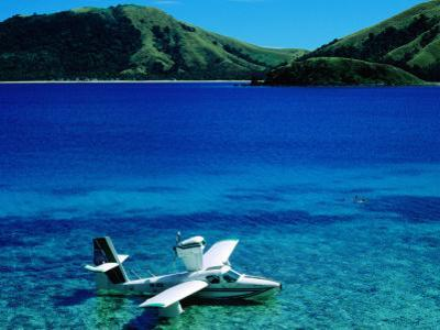 Seaplane in Water Between Yasawa and Sawa-I-Lau Islands, Fiji by Mark Daffey