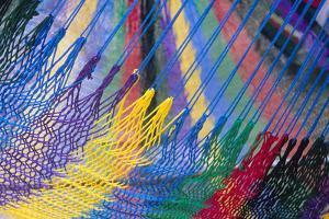 Colorful strings in handmade hammock, Akumal Yucatan, Mexico by Mark Gibson