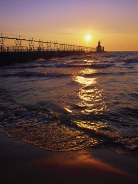 Sunset at Lighthouse, Lake MIchigan, MI by Mark Gibson