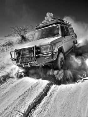 Damaraland, Four Wheel Drive Vehicles are the Best Means of Travel in Desert Environment, Namibia by Mark Hannaford