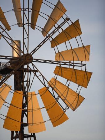 Erongo Region, Okahandja, the Fins of a Windmill Highlighted by the Setting Sun, Namibia by Mark Hannaford