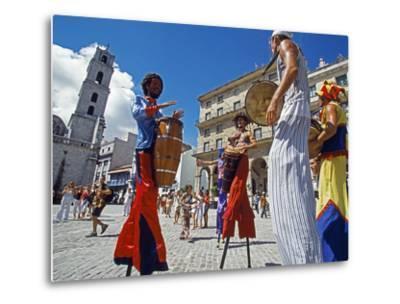 Los Zancudos, Stilt Dancers in Old Havana World Heritage Area, Cuba by Mark Hannaford
