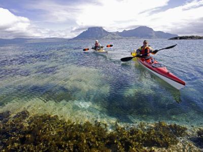 Nordland, Helgeland, Sea Kayakers Explore Calm Coastal Waters of Southern Nordland, Norway by Mark Hannaford