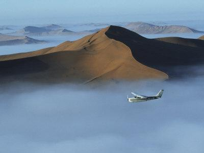 Safari Flights over Red Sand Dunes of Sossusvlei with Early Morning Mist, National Park, Namibia