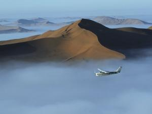 Safari Flights over Red Sand Dunes of Sossusvlei with Early Morning Mist, National Park, Namibia by Mark Hannaford