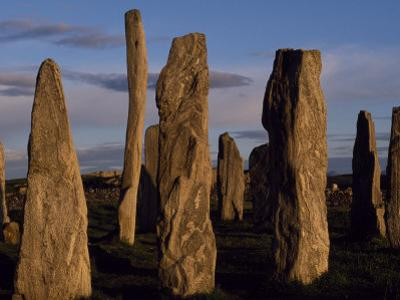 Sunset over the Central Circle of Ancient Standing Stones at Callanish, Dating to Neolithic Times by Mark Hannaford