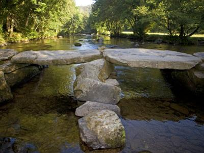 Tarr Steps a Prehistoric Clapper Bridge across the River Barle in Exmoor National Park, England by Mark Hannaford