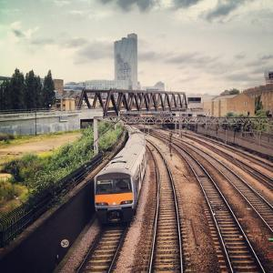 Metro Train Travelling on Railway to London City by Mark Jones Images