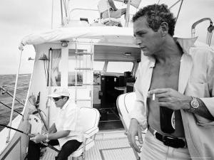 Actor Paul Newman Fishing with a Friend by Mark Kauffman