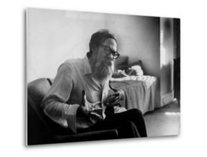 American Poet John Berryman Expressing Himself While Sitting in His Semi Empty Apartment by Mark Kauffman