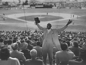 Enthusiastic Fan Cheering in Stands During Cuban Baseball Game by Mark Kauffman